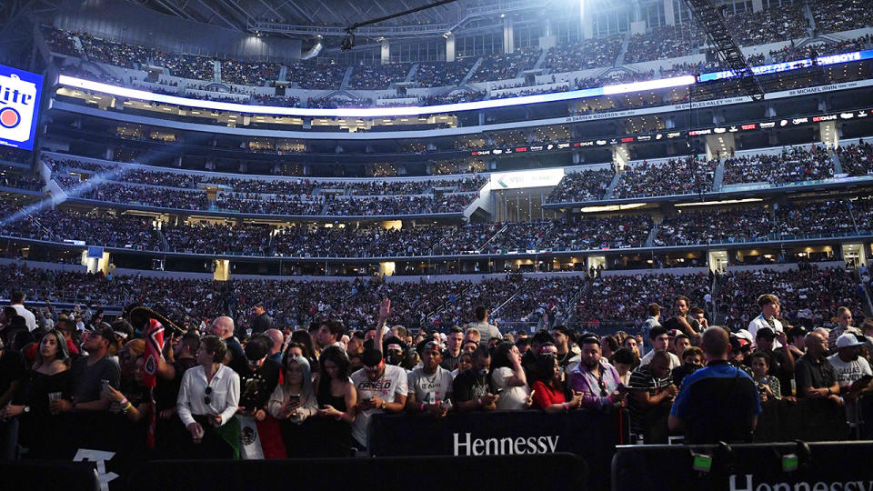 The crowd, pictured here cheering before Canelo Alvarez and Billy Joe Saunders' fight.