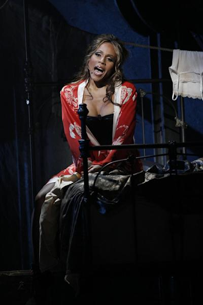 "This theater publicity image released by The Hartman Group shows Deborah Cox during a performance of ""Jekyll & Hyde"" playing at the Marquis Theatre in New York. (AP Photo/The Hartman Group, Chris Bennion)"