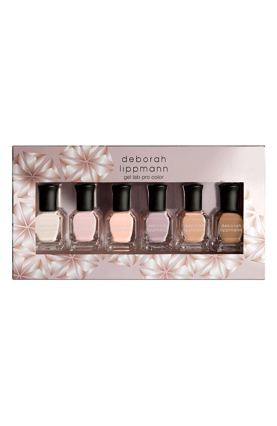 """<p><strong>Deborah Lippmann</strong></p><p><strong>$36.00</strong></p><p><a href=""""https://go.redirectingat.com?id=74968X1596630&url=https%3A%2F%2Fwww.nordstrom.com%2Fs%2Fdeborah-lippmann-undressed-gel-lab-pro-nail-color-set-usd-72-value%2F5394301&sref=https%3A%2F%2Fwww.cosmopolitan.com%2Fstyle-beauty%2Ffashion%2Fg13602855%2Fbest-gift-ideas-for-women%2F"""" rel=""""nofollow noopener"""" target=""""_blank"""" data-ylk=""""slk:Shop Now"""" class=""""link rapid-noclick-resp"""">Shop Now</a></p><p>You know she likes to sport a different nail color every week. So get her a pretty polish set that has a range of neutral and pastel shades suited for all occasions.</p>"""