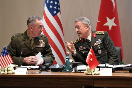 Turkey's Chief of Staff General Akar chats with U.S. Chairman of the Joint Chiefs of Staff Dunford during a meeting in Antalya