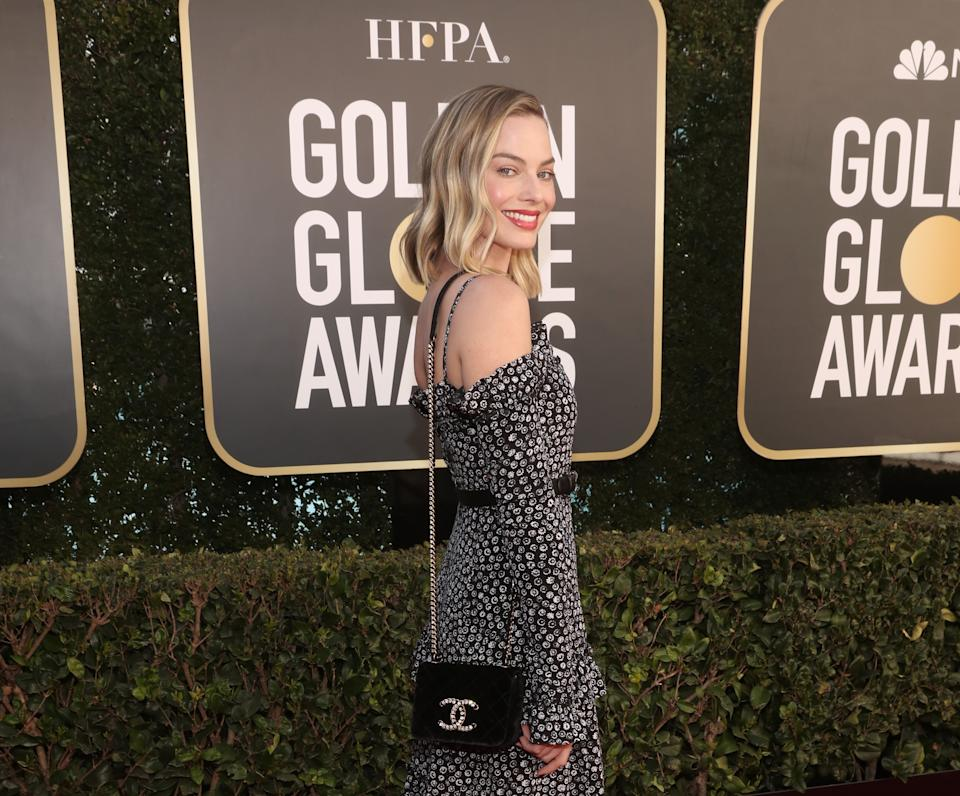 Margot Robbie wears a black and white Chanel dress at the 78th Annual Golden Globe Awards held at The Beverly Hilton and broadcast on February 28, 2021 in Beverly Hills, California. -- (Photo by Todd Williamson/NBC/NBCU Photo Bank via Getty Images)