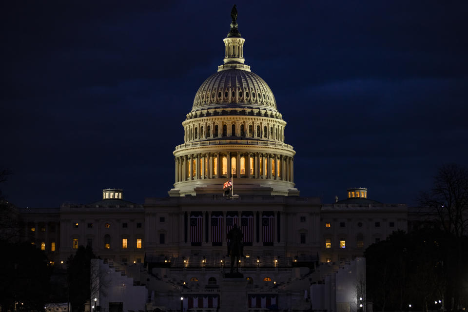 <p>The US Capitol and the stages built for the Presidential Inauguration ceremony on 17 January 2021 in Washington, DC. After last week's riots at the U.S. Capitol Building, the FBI has warned of additional threats in the nation's capital and in all 50 states.</p> (Getty Images)