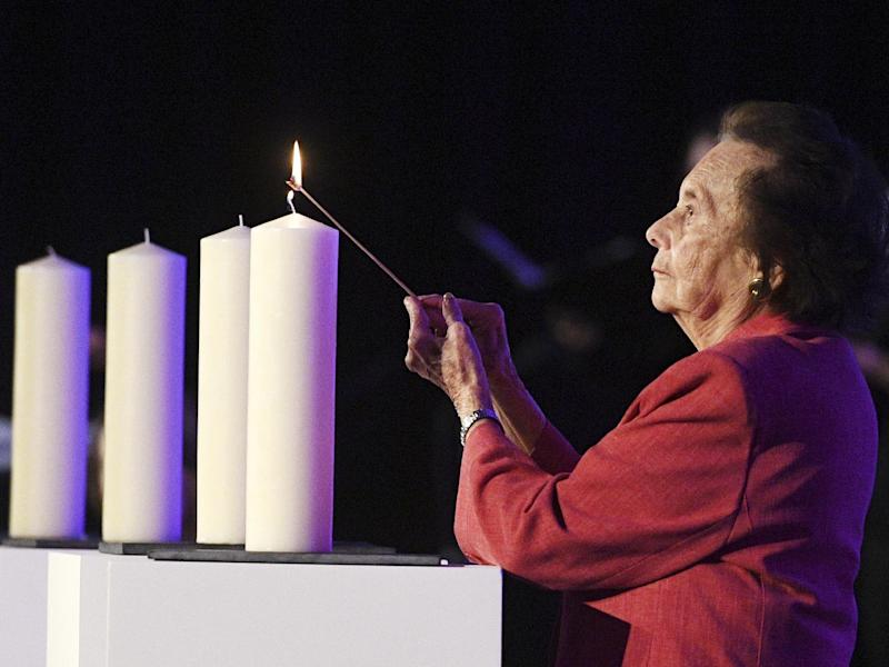 Holocaust survivor Lily Ebert lights a candle at a National Holocaust Memorial Day event in London 2017: EPA