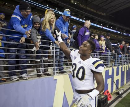Myles Jack is expected to continue to have a role with the Bruins' offense. (AP)
