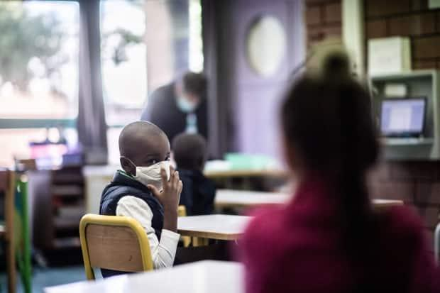 The new health orders require all students from Grade 4 up to wear non-medical masks, even while seated at their desks.  (Martin Bureau/AFP via Getty Images - image credit)