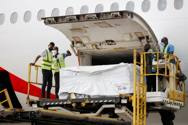 FILE PHOTO: Workers offload boxes of AstraZeneca/Oxford vaccines as the country receives its first batch of coronavirus disease (COVID-19) vaccines under COVAX scheme, in Accra