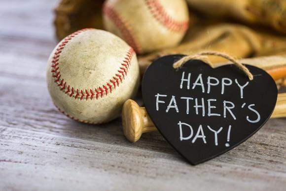 A sign in a heart says happy Father's Day