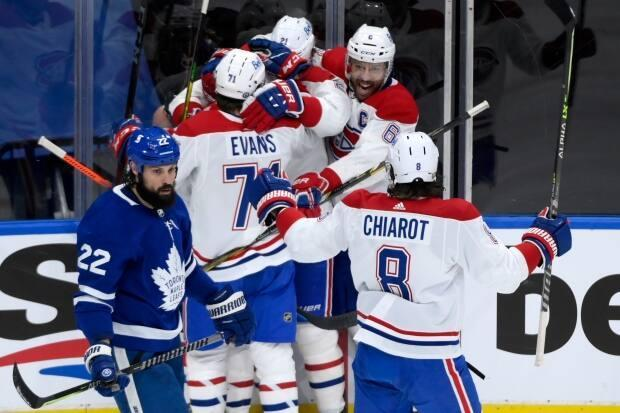 Montreal Canadiens players celebrate a goal by forward Brendan Gallagher during the team's 3-1 win over the Toronto Maple Leafs on Monday. (Nathan Denette/The Canadian Press - image credit)