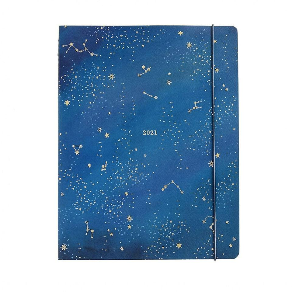 "The person who reads horoscopes more than meeting agendas can stay on track with this celestial planner featuring dainty constellations, gold foil accents, and matching gold stickers. Bonus: It has a perforated notes section, so you can tear off grocery lists to support your bid to lay off the delivery orders this year. $23, Paper Source. <a href=""https://www.papersource.com/desk/2021-night-sky-jumbo-booklet-planner-10011268.html"" rel=""nofollow noopener"" target=""_blank"" data-ylk=""slk:Get it now!"" class=""link rapid-noclick-resp"">Get it now!</a>"