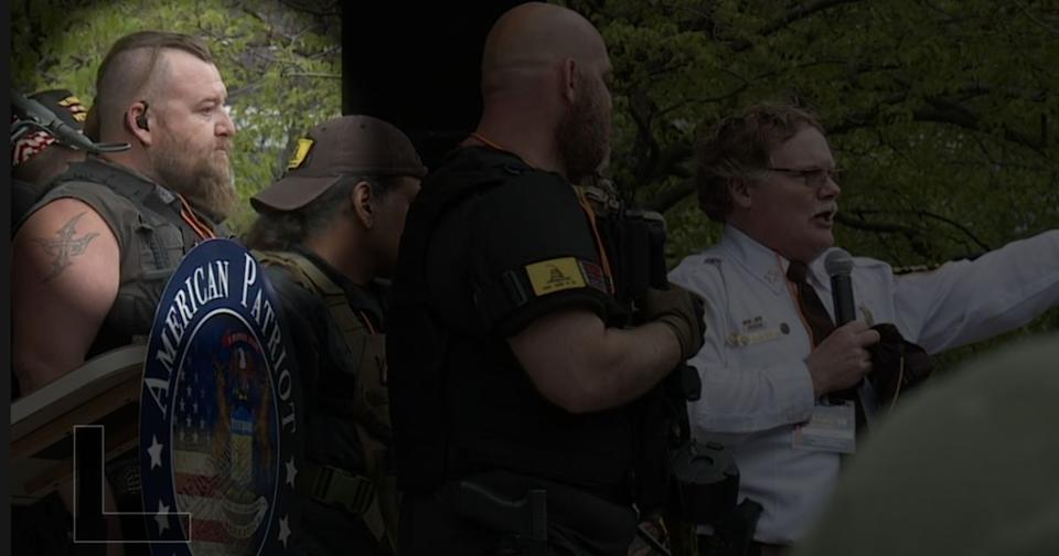William Null, charged in a militia plot to kidnap Democratic Michigan Gov. Gretchen Whitmer, appears onstage alongside Barry County Sheriff Dar Leaf at an anti-lockdown rally on May 18, 2020, in Grand Rapids, Michigan. (Photo: Fox17)
