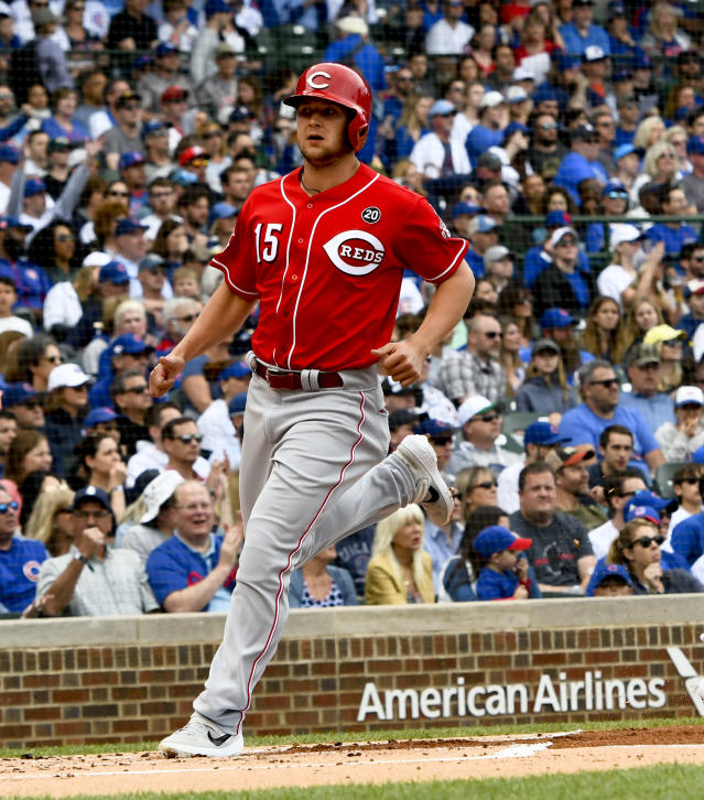 Cincinnati Reds' Nick Senzel (15) scores during the first inning of a baseball game against the Chicago Cubs Sunday, May 26, 2019, in Chicago. (AP Photo/Matt Marton)