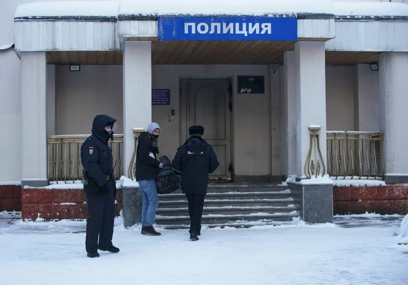 An ally of detained Russian opposition leader Navalny enters a police station, in Khimki