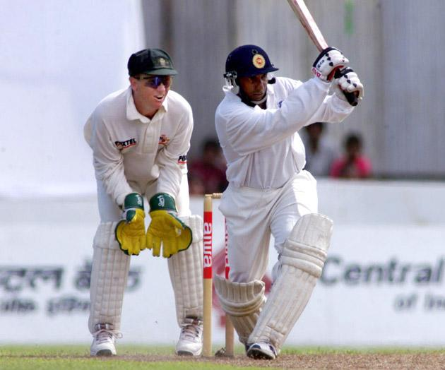 22 Sep 1999:  Arivinda de Silva of Sri Lanka on the attack, with Ian Healy of Australia looking on, during day one of the second test between Sri Lanka and Australia at Galle International Stadium, Galle, Sri Lanka.X Mandatory Credit: Hamish Blair/ALLSPORT