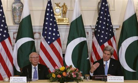 U.S. Secretary of State Kerry and Pakistan's National Security and Foreign Affairs Advisor Aziz deliver opening remarks at a ministerial-level meeting at the State Department in Washington