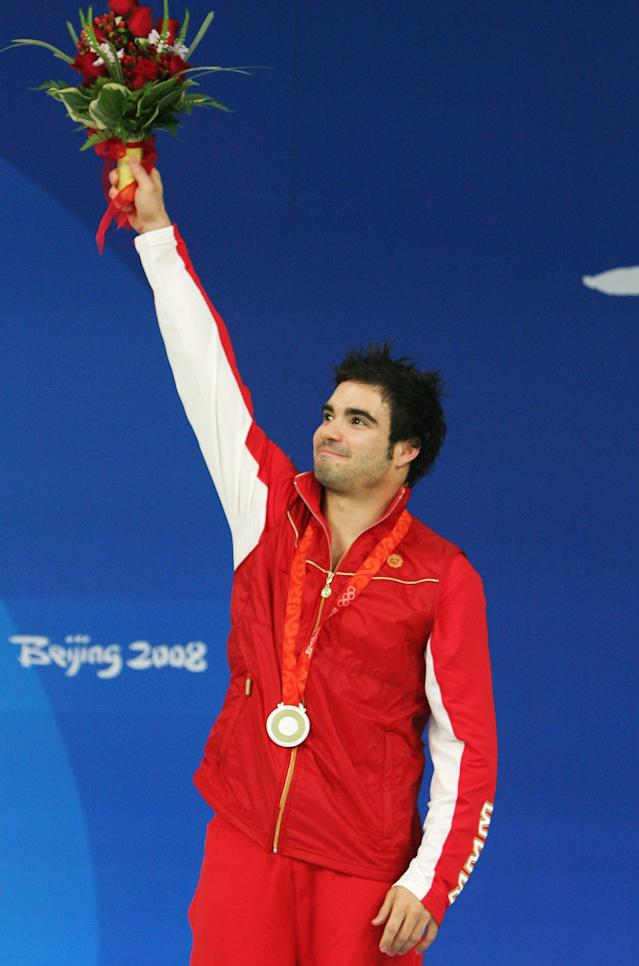 BEIJING - AUGUST 19: Silver medalist Alexandre Despatie of Canada celebrates after the Men's 3m Springboard Fiinal at the National Aquatics Center on Day 11 of the Beijing 2008 Olympic Games on August 19, 2008 in Beijing, China. (Photo by Streeter Lecka/Getty Images)