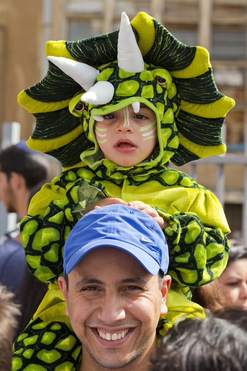 Israelis take part in a parade to celebrate the Jewish holiday of Purim in the central Israeli city of Netanya on February 24, 2013. (Jack Guez/AFP/Getty Images)