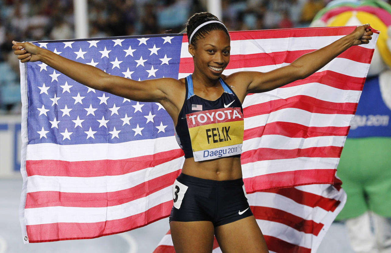 USA's Allyson Felix celebrates winning bronze in the Women's 200m final at the World Athletics Championships in Daegu, South Korea, Friday, Sept. 2, 2011. (AP Photo/Anja Niedringhaus)