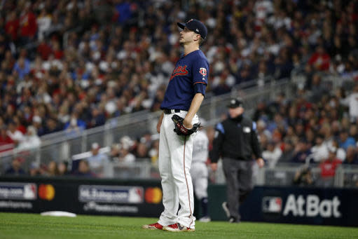 Minnesota Twins starting pitcher Jake Odorizzi watches a home run hit by New York Yankees' Gleyber Torres during the second inning in Game 3 of a baseball American League Division Series, Monday, Oct. 7, 2019, in Minneapolis. (AP Photo/Bruce Kluckhohn)
