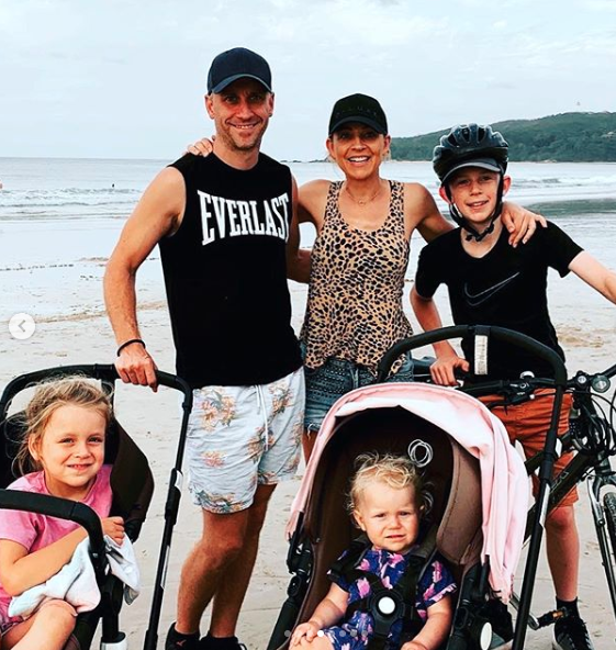 Carrie Bickmore and her family on the beach posing for the camera