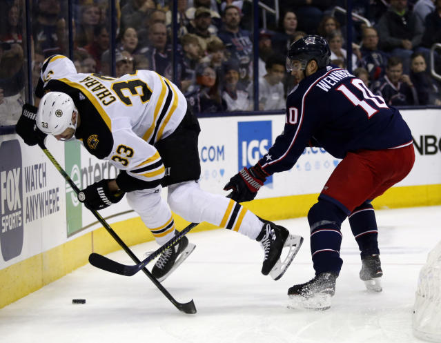 Columbus Blue Jackets forward Alexander Wennberg, right, of Sweden, trips Boston Bruins defenseman Zdeno Chara, of Slovakia, during the second period of an NHL hockey game in Columbus, Ohio, Tuesday, April 2, 2019. Wennberg was called for the penalty. (AP Photo/Paul Vernon)