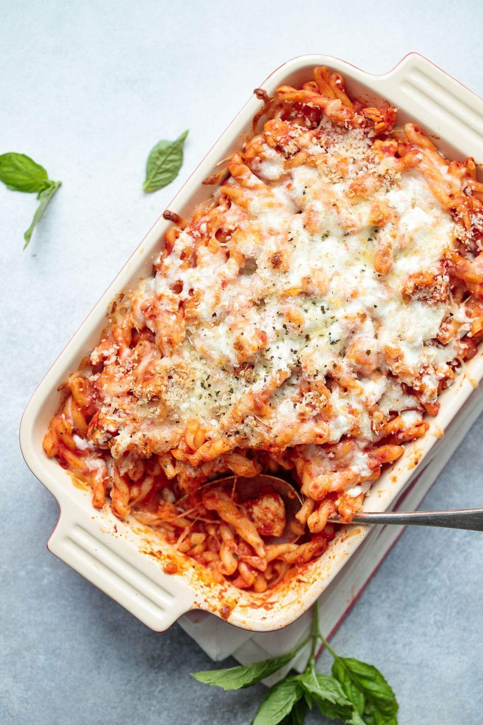 """<p>The real star of this pasta bake is the topping: Toasted breadcrumbs and melty mozzarella come together for an unforgettable finish.</p><p><strong>Get the recipe at <a href=""""https://www.loveandoliveoil.com/2018/06/cheesy-chicken-parmesan-pasta-bake.html"""" rel=""""nofollow noopener"""" target=""""_blank"""" data-ylk=""""slk:Love and Olive Oil"""" class=""""link rapid-noclick-resp"""">Love and Olive Oil</a>.</strong></p>"""