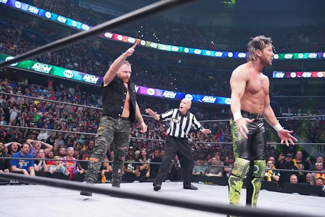 """Jon Moxley is seen in the ring with Kenny Omega during an episode of AEW """"Dynamite."""" (Photo Courtesy of AEW)"""