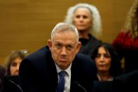 FILE PHOTO: Benny Gantz, leader of Blue and White party, reacts during a committee meeting at the Knesset, Israel's parliament, in Jerusalem