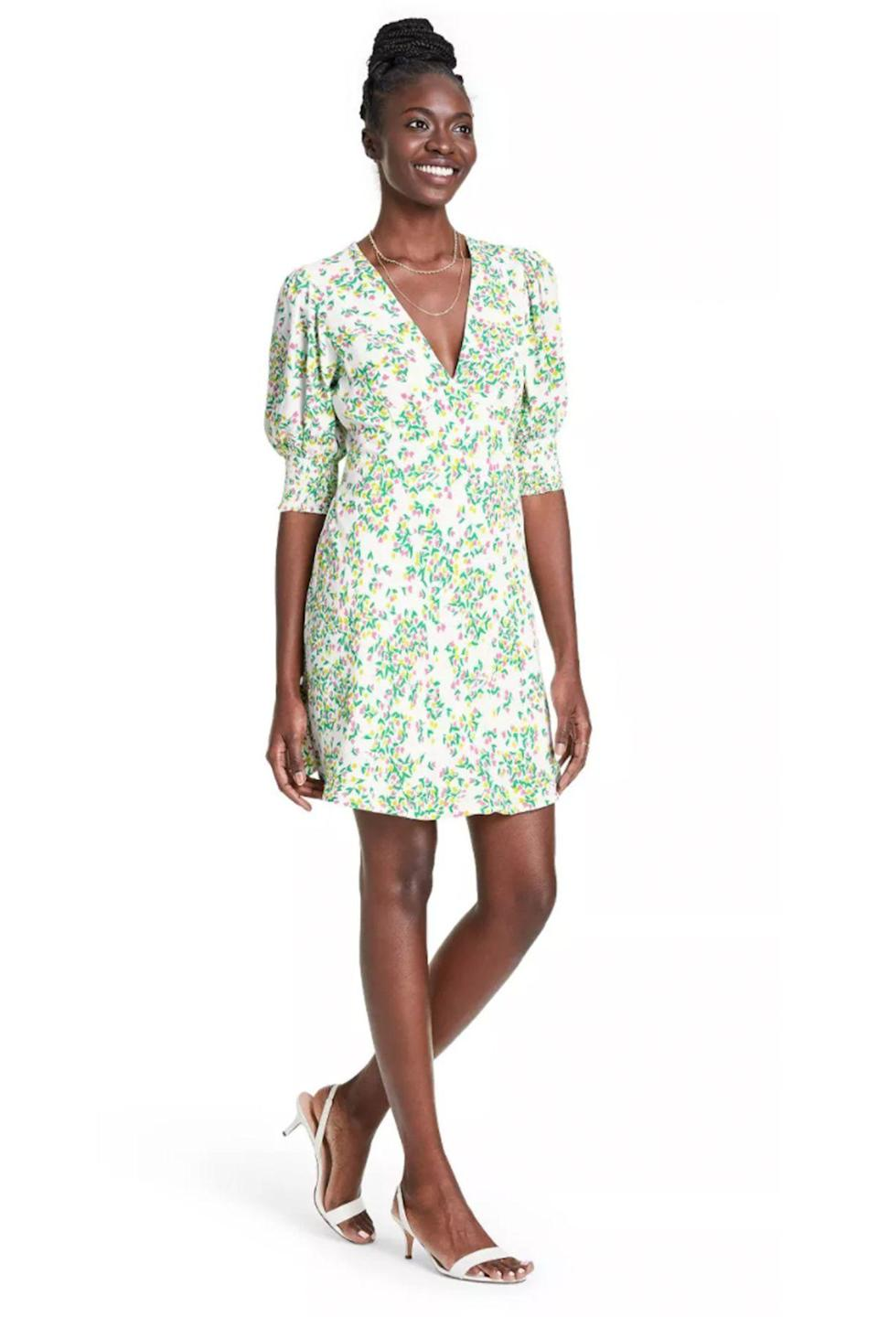 """<p><strong>RIXO for Target</strong></p><p>target.com</p><p><strong>$45.00</strong></p><p><a href=""""https://www.target.com/p/floral-puff-sleeve-swing-dress-rixo-for-target-cream-green/-/A-82020568"""" rel=""""nofollow noopener"""" target=""""_blank"""" data-ylk=""""slk:Shop Now"""" class=""""link rapid-noclick-resp"""">Shop Now</a></p>"""