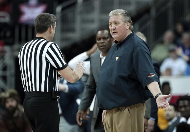 West Virginia head coach Bob Huggins talks to an official during the first half of an NCAA college basketball game against Kansas in the Big 12 men's tournament Friday, March 15, 2019, in Kansas City, Mo. (AP Photo/Charlie Riedel)