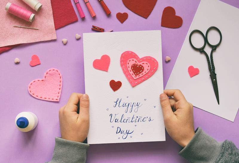 Making of handmade Valentine greeting card from felt. Children's DIY, hobby concept, gift with your own hands. Valentine's Day decoration