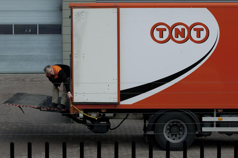 FILE - In a Feb. 21, 2012 file photo a TNT delivery truck is seen in Hoofddorp, near Amsterdam, Netherlands. United Parcel Service Inc. said Monday March 19, 2012, it has agreed to buy TNT Express NV for $6.77 billion (€5.16 billion). (AP Photo/Peter Dejong/file)