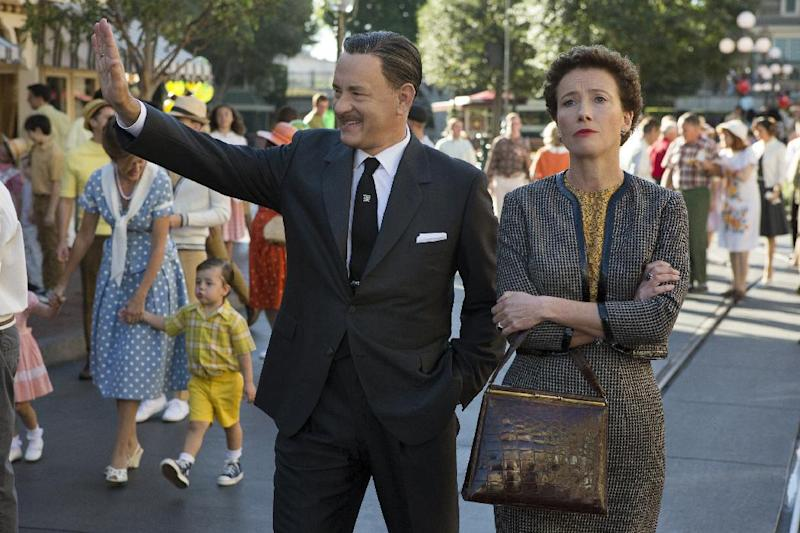 """This image released by Disney shows Tom Hanks as Walt Disney, left, and Emma Thompson as author P.L. Travers in a scene from """"Saving Mr. Banks."""" (AP Photo/Disney, François Duhamel)"""