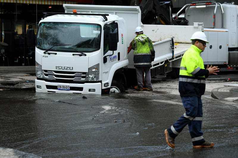 A truck stuck in a sinkhole at Double Bay in Sydney.