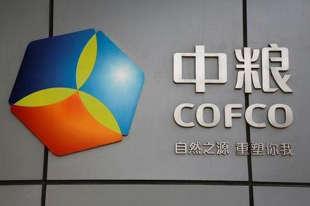 FILE PHOTO: The company logo of China Oil and Foodstuffs Corporation (COFCO) is seen at its headquarters in Beijing