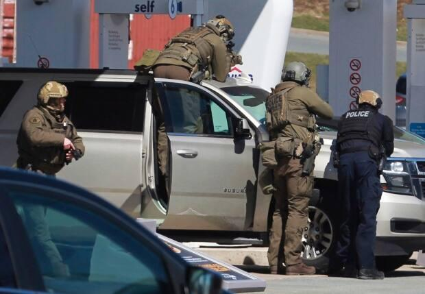 Members of the RCMP emergency respond team surrounded the Irving Big Stop in Enfield, N.S., where two RCMP officers shot and killed the man responsible for murdering 22 people.