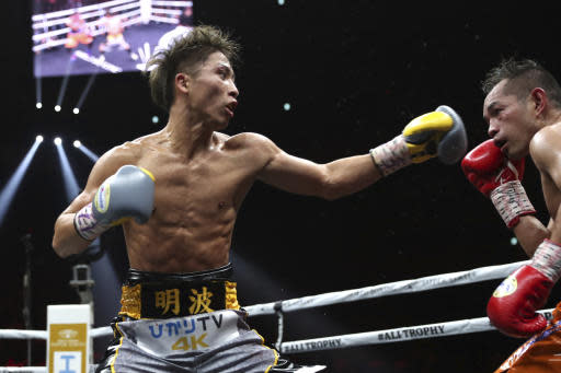 Japan's Naoya Inoue, left, sends a left to Philippines' Nonito Donaire in the sixth round of their World Boxing Super Series bantamweight final match in Saitama, Japan, Thursday, Nov. 7, 2019. Inoue beat Donaire with a unanimous decision to win the championship. (AP Photo/Toru Takahashi)