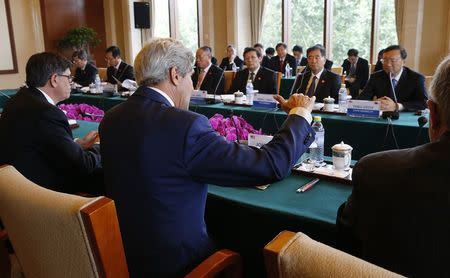 U.S. Secretary of State Kerry and Treasury Secretary Lew participate in a Joint Session on Climate Change and Clean Energy with China's Minister of Finance Lou, China's Vice Premier Wang and State Councilor Yang in Beijing