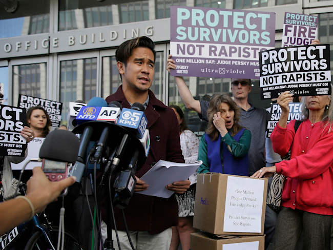 Sexual assault survivor Chris Huqueriza speaks at a rally before over one million signatures were delivered to the California Commission on Judicial Performance calling for the removal of Judge Aaron Persky from the bench Friday, June 10, 2016, in San Francisco. A group of California lawmakers joined women's rights advocates Friday in urging a California agency to take action against the judge who sentenced a former Stanford University swimmer to six months in jail for sexually assaulting an unconscious woman. (AP Photo/Eric Risberg)