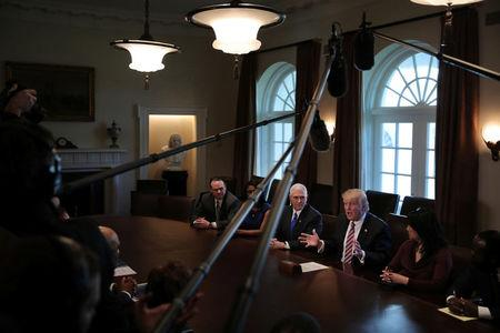 U.S. President Donald Trump and Vice President Mike Pence attend a meeting with the Congressional Black Caucus Executive Committee at the White House in Washington, DC, U.S., March 22, 2017. REUTERS/Carlos Barria