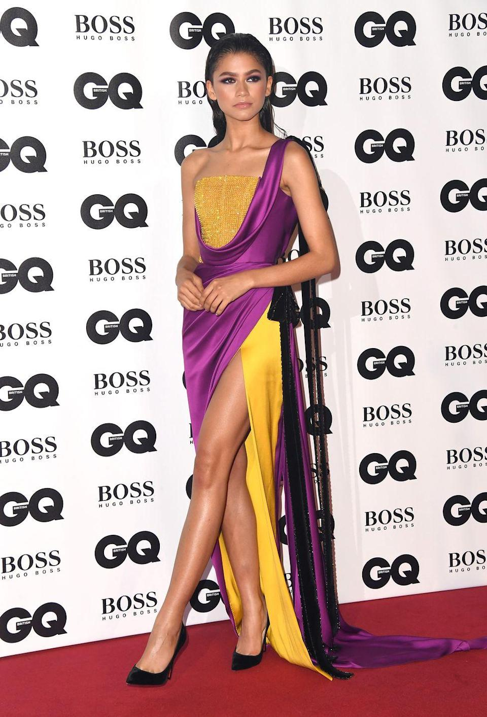 <p>She really turned heads at <em>GQ</em>'s 2018 Men of the Year Awards. This Ralph & Russo gown made her glitter in gold, and the dramatic purple drapery gave the dress some added elegance.</p>
