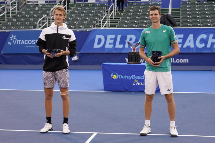 Sebastian Korda, left, and Hubert Hurkacz of Poland, right, pose with their trophy after the men's singles final of the Delray Beach Open tennis tournament, Wednesday, Jan. 13, 2021, in Delray Beach, Fla. Hurkacz won 6-3, 6-3. (AP Photo/Lynne Sladky)