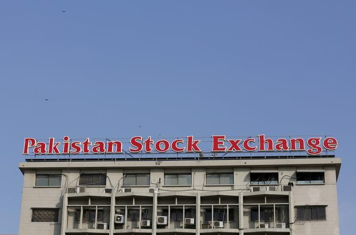 A sign of the Pakistan Stock Exchange is seen on its building in Karachi