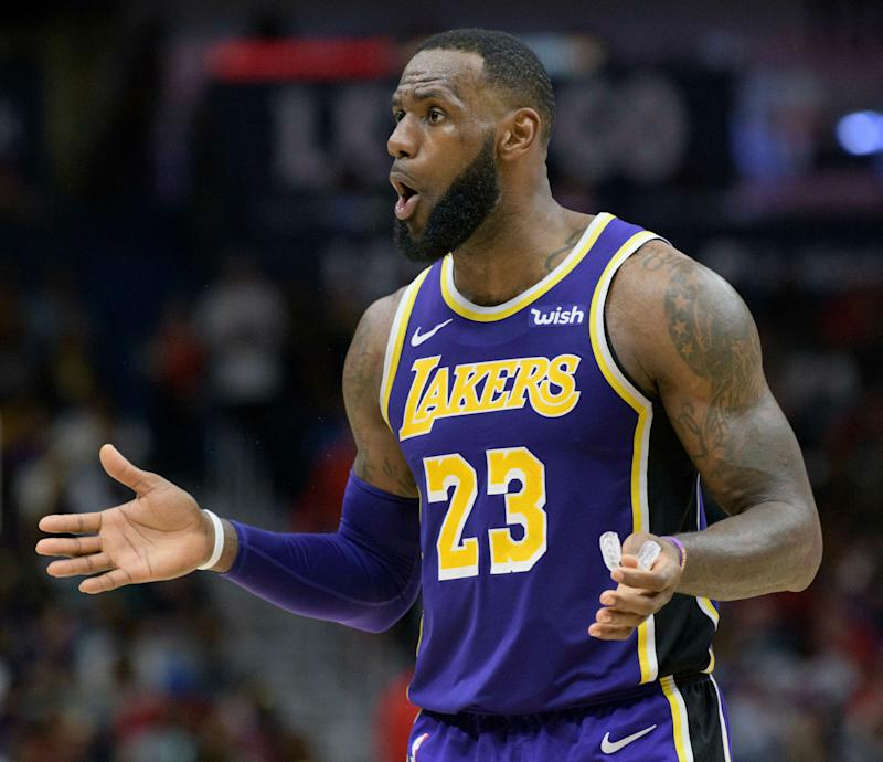 Los Angeles Lakers forward LeBron James (23) reacts to a call against the New Orleans Pelicans in the second half of an NBA basketball game in New Orleans, La. Saturday, Feb. 23, 2019. (AP Photo/Matthew Hinton)