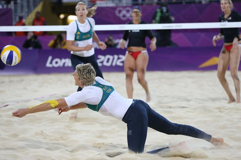 Natalie Cook from Australia dives for a ball during the Beach Volleyball match against USA at the 2012 Summer Olympics, Saturday, July 28, 2012, in London. (AP Photo/Petr David Josek)