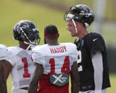 Atlanta Falcons quarterback Matt Ryan, right, talks with wide receivers Marvin Hall (17) and Justin Hardy (14) during NFL football training camp, Tuesday, Aug. 7, 2018, in Flowery Branch, Ga. (AP Photo/John Bazemore)