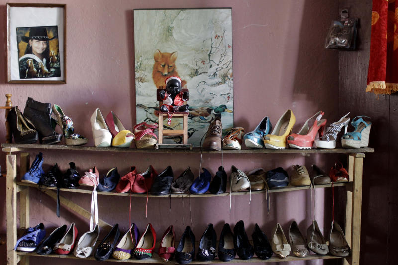 In this Oct 11, 2013 photo, shoes for sale are displayed on a shelf inside the home of a small business owner in Havana, Cuba. Some 436,000 Cubans are running or working for private small businesses under President Raul Castro's package of social and economic reforms begun in 2010. (AP Photo/Franklin Reyes)