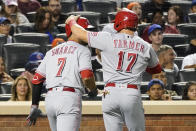 Cincinnati Reds' Kyle Farmer (17) and Eugenio Suarez (7) celebrate after scoring on Farmer's three-run home run in the fourth inning of the baseball game agains the New York Mets, Saturday, July 31, 2021, in New York. (AP Photo/Mary Altaffer)