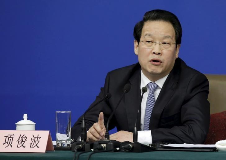 Xiang Junbo, chairman of CIRC, answers a question at a news conference in Beijing