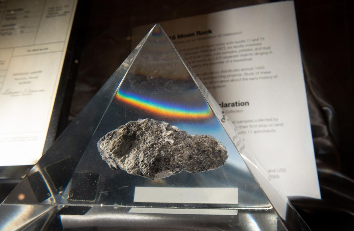A rock from the moon is seen displayed inside a plexiglass case during a gala reuniting the Apollo team responsible for the historic lunar landing 50 years ago aboard the USS Hornet in Alameda, California on July 16, 2019. (Photo by JOSH EDELSON / AFP)        (Photo credit should read JOSH EDELSON/AFP/Getty Images)