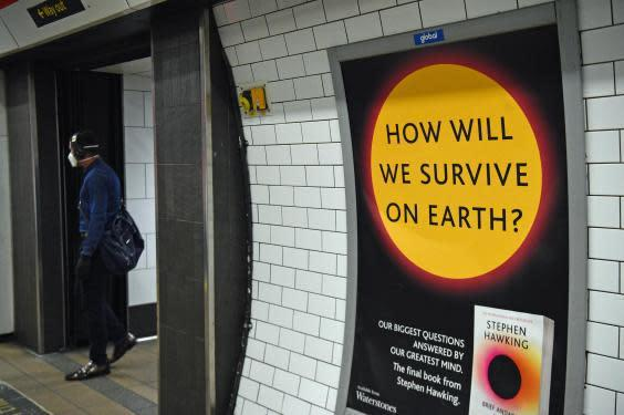 A poster promoting a book by Stephen Hawking on a passageway in London's Oxford Street Underground station the day after Prime Minister Boris Johnson put the UK in lockdown to help curb the spread of the coronavirus. (Kirsty O'Connor/PA Wire/PA Images)